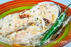 Ginataang Salmon or Salmon Cooked in Coconut Cream (or coconut milk) is a simple Filipino fish recipe. You can use this as a guide to make your meal more enjoyable. This dish is very easy and quick to prepare; in fact, your Ginataang Salmon will be ready in less than 30 minutes.