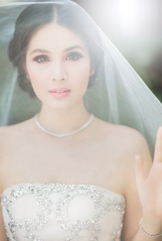 Wedding photoshoot with veil | Behind The Scenes Of Our Cover Story With Sandra Dewi | http://www.bridestory.com/blog/behind-the-scenes-of-our-cover-story-with-sandra-dewi
