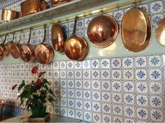 Copper pots hanging in a French kitchen