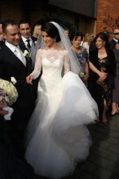 Steven khalil wedding dress. So elegant and timeless. Love the detail of the lace on this dress.