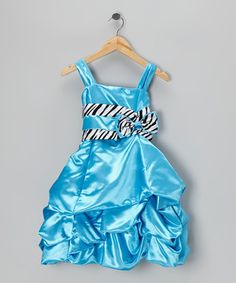 This dress has a big helping of elegance mixed with wild charm. A fairy-tale pickup hem adds a timeless touch, while the glam zebra sash puts a sassy spin on this fancy frock.