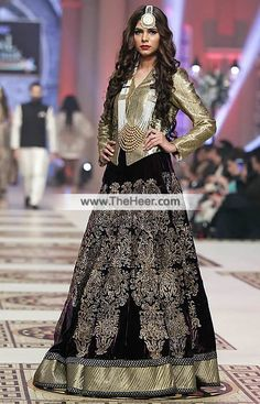 BW6986 Metallic Gold Black Fancy Net Velvet Crinkle Chiffon Lehenga This lehenga suit is ideal for wedding occasions where you want to traditional wear with a modern look.. .   Top: Metallic Gold Fancy Net Features plain stylish and charming shirt. Full length sleeves. V-neckline. Concealed hooks closure front. Lining inside.   Bottom: Dark Eggplant Velvet Comes with glorious lehenga skirt adorned fabulous embellishments all over and dual applique work border on the hemline. Drawstring…