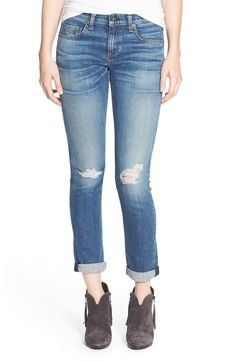 Spotted at the NSale! Ripped knees and shadow creases add lived-in charm to these rag & bone medium-blue jeans that offer a slim take on slouchy boyfriend jeans.
