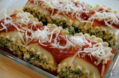 Spinach Lasagna Rolls 9 lasagna noodles, cooked 10 oz frozen chopped spinach 15 oz fat free ricotta cheese 1/2 cup grated Parmesan cheese 1 egg salt and fresh pepper 32 oz tomato sauce 3 oz part skim mozzarella cheese, shredded