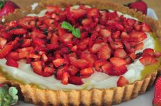 Strawberry season comes in fierce in California. All of the sudden, those red little beautiesare everywhere and so cheap, they're practically free. Strawberry Basil Tart with Lime Curd
