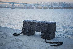 south korean design studio craft combine has recycled plastic containers to create a floating furniture series for use during flood-related emergencies. Korean Design, Material Design, Design Art, Graphic Design, Hiking Boots, Lion Sculpture, Objects, Statue, Crafts