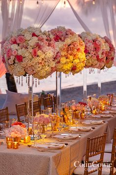 A romantic table is lined with a combination of high and low centerpieces of roses and hydrangeas in soft pink and white hues. Wedding Centerpieces, Flowers, Floral Arrangements, Candelabra, Pomander