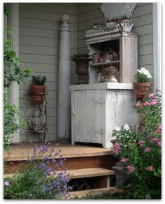 I am thinking I need some sort of chest/potting bench at the back wall on my porch.  Love this idea!