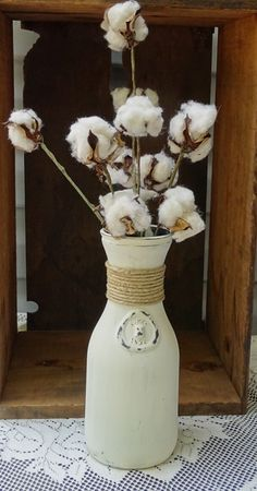 A personal favorite from my Etsy shop https://www.etsy.com/listing/489619813/antique-glass-milk-bottle-with-cotton