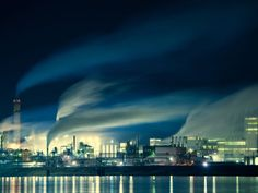 Muscatine, Iowa. Photograph by Kyle Jeffery. Under the cover of darkness, industry continues to expel smoke and steam into the wind currents along the Mississippi River. This image was captured in Muscatine, Iowa, as part of a 110-day expedition down the entire length of the river.