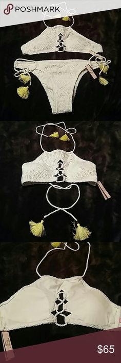 Victoria's Secret bikini White lace/crochet. Top ties in back and halter with a brown bead and yellow tassel. Bottoms over customizable fit with ties on the sides. Top size Small, Bottoms size Large. !!! ALSO AVAILABLE IN BLACK !!! same sizes Victoria's Secret Swim Bikinis