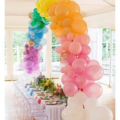 A party under a rainbow from Rainbow Parties, Rainbow Birthday Party, Unicorn Birthday Parties, Unicorn Party, Kids Rainbow, Rainbow Balloon Arch, Balloon Garland, Balloon Decorations, Tulle Balloons