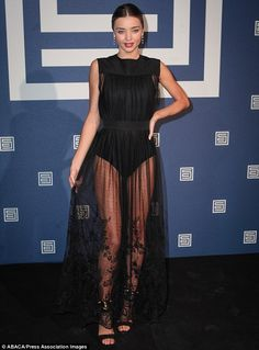 Miranda Kerr wore a a black leotard under a sheer overlay at the Shiatzy Chen's runway show...so stunning