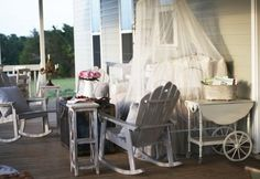 While the farmhouse itself is only about 1,100 square feet, the back porch adds another 600 square feet of living space. An antique bed covered with mosquito netting serves as both a day bed for naps and a sofa in an outdoor living room when paired with rocking Adirondack chairs and a rolling cart repurposed as a side table.