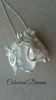 Quarz pendant in sterling silver with charms