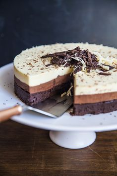 Triple Chocolate Mousse Cake. A showstopper if there ever was one. | Recipe from sortedfood.com