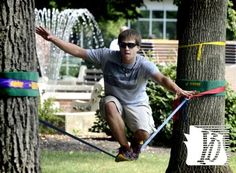 Tyler Mauk of Reading practices slacklining on the York College campus Monday, August 26, 2013. He was visiting his high school friend Mike Risley, who is a chemical engineering junior at the school. Slacklining is a form of tightrope walking but uses a less-taut line. It was the first day of fall classes at the school. Bill Kalina photo bkalina@yorkdispatch.com