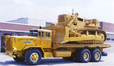 Big Oshkosh carrying a 385hp Caterpillar D9G.Have a picture of a 700hp D10 in the dump body of 1380hp 150 Caterpillar 785
