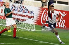 Landon Donovan of the USA celebrates scoring the second goal during the Mexico v USA, World Cup Second Round match played at the Jeonju World Cup Stadium, Jeonju, South Korea on June 17, 2002. The USA won 2-0.
