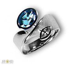 Atelier Reister - Ring aus 750/- Weißgold mit einem Aquamarin und Brillanten im Navetteschliff.