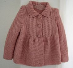 Thank you for visiting my shop!  This little, stylish, pink coat is handmade for your 2 to 3-year-old girls. It is made of %25 wool and %75 acrylic, soft, rose pink yarns and fastened at the top with hand knitted 3 buttons. It is knitted (including its buttons) with great care, in a smoke-free, pet-free home and never worn. It is suitable both for casual dressing and some special gatherings. It is designed to fit your childs waist and to cover down to upper legs.  It is ready for shipping…