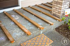 If you've ever thought about turning your cement porch into a wood deck, it's surprisingly easy! Here are some thoughts, tips, & photos from our experience! Deck Over Concrete, Concrete Porch, Cement Patio, Porch Wood, Concrete Front Steps, Front Porch Furniture, Painted Concrete Floors, Patio Slabs, Wood Patio