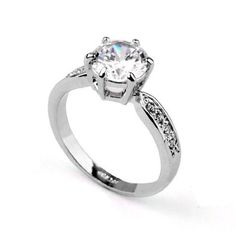 Magic Collection White Gold Finish 2 Carat Solitaire Round Cubic Zirconia Engagement Ring R86 (White Gold Finish, 5) Magic Collection,http://www.amazon.com/dp/B00BAEPVWC/ref=cm_sw_r_pi_dp_1uFHsb0DYETJNG9Z