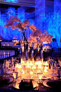 When planning your wedding at The Ritz-Carlton, Grand Cayman, consider incorporating tropical blooms like the delicate orchid. A few orchids placed in glass vases of varying heights add elegance to any table.