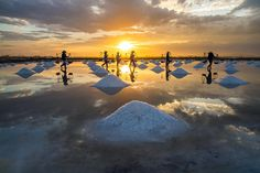 People Harvesting Salt at Sunset, Vietnam. Smithsonian 10th Annual Photo Contest Finalists