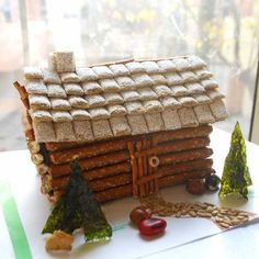 Miniature log cabin of pretzels and shredded wheat cereal