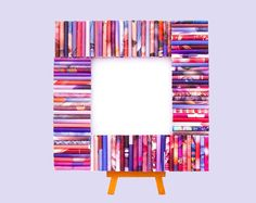 This frame is made from recycled magazines in shades of pink and purple. The core is made from layers of recycled cardboard. This is a one-of-a-kind item and no one else will have the same one. Makes a great eco-friendly gift. Available at http://www.etsy.com/shop/gr3een