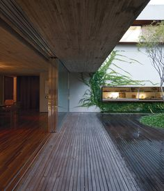Four custom-built sliding doors divide indoor and outdoor spaces. Photo by Cristóbal Palma.