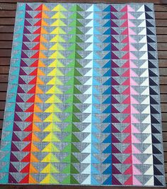 The  Birds of a Feather  quilt is finished. The colors and layout of this quilt really pack a punch!           I so enjoyed the color play ...
