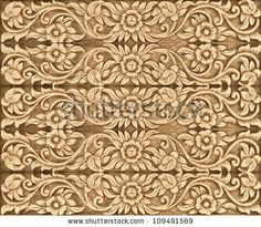 Pattern of wood flower carve as background by WitthayaP, via ShutterStock