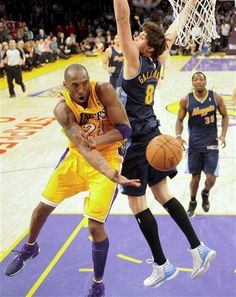May 1, Kobe Bryant, left, passes around Denver Nuggets' Danilo Gallinari during the second half of a NBA first-round playoff game