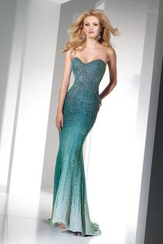 Alyce famous heavily hand beaded silk ombre chiffon mermaid prom gown with sweetheart neckline and sweep train. It's stunning and sparkling!    Our Price: $580.00