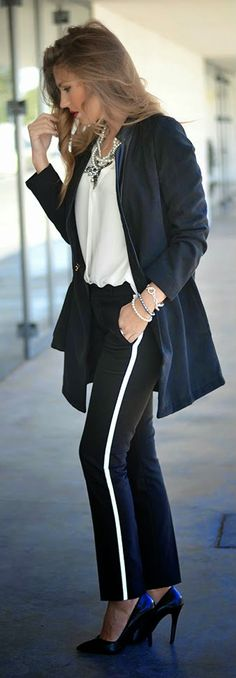 TUXEDO CHIC - pants with white stripe, black long coat, white fall necklace, accessories, black nude pumps.