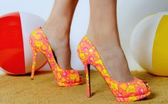 Day-glo turns to night with these Nicholas Kirkwood neon yellow and pink pumps.