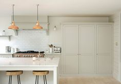 This large Classic English kitchen in Clapham, London is centred around a beautiful Mercury range and marble island.