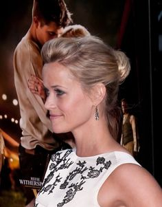 Reese Witherspoon wears an elegant bun