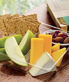 """Starbucks Bistro Boxes! My fav contains brie, cheddar cheese, almonds, dried cranberries, apples and multigrain crackers + Chai Latte = HEAVEN.  Best lunch ever.  Remember, those """"Lunchables"""" when we were kids? These are Lunchables for adults!"""