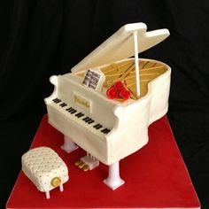 Wedding cake inspired by music - White baby grand piano cake: butter cream icing, gum paste flower and music, fondant keys. Description from pinterest.com. I searched for this on bing.com/images