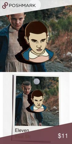 """Eleven - Stranger Things Enamel Pin ~*~*~*~*~*~ Stranger Things ~*~*~*~*~*~  Eleven is awesome! The feral child with telekinesis has quickly become one of the most popular television characters in history.  Our Eleven pin is here and ships immediately!  • 1.5"""" Tall, Hard Enamel with Gold • V2 with Updated Colors • Double posted to be more secure • Does not include waffles • May Give you Psychic Powers 🔮  Not officially licensed or endorsed by the creators of Stranger Things Real Sic Jewelry…"""