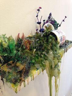 "Jon Duff, ""Meeting Cup"" (2015), polyurethane resin, acrylic, mug, and plywood, 18"" x 12"" x 6"" (photo by Jillian Steinhauer for Hyperallergic)"