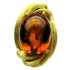 Cabouchon citrine and 18 karat textured yellow gold. Henry Dunay