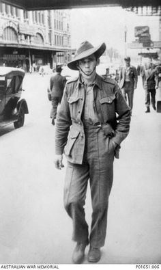 Informal portrait of Aboriginal serviceman, Private Claude Henry McDonald, of Richmond, Vic, walking down a Melbourne street. Pte McDonald enlisted on 7 August 1941 in Newtown, VIc, and served with the 10th Australian Despatch Radar Section in New Guinea, Torakina and Bougainville. He was discharged on 9 January 1946.