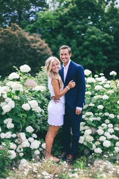 This is an adorable engagement photo! I love the scenery in the background and how it almost looks like she is wearing her white lace dress!