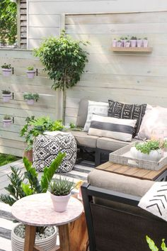 love the oasis of plants and fun textiles