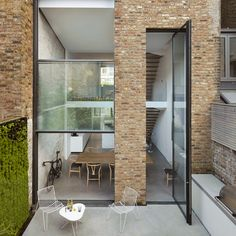 London house extension by Alexander Martin features a double-height window wall — Dezeen Slot Machine, Cubes, Portal, Elderly Home, London House, House Extensions, Dezeen, Window Wall, Large Windows
