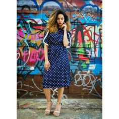"""Vintage navy and white polka dot dress with matching tie belt. Unique capped sleeves. (Small white spot on top, but not noticeable because of white polka dots). 100% polyester Tag size 16 Bust 44"""" Waist stretches to 44"""" Hips 52"""" $26 shipping included SOLD!!"""